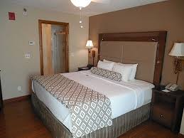 a king bed with a simmons world class beauty rest pillow top mattress and plush linens additional amenities include a comfortable work desk and chair bedroompicturesque comfortable desk chairs enjoy work