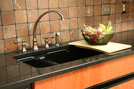 Cutting Board Cabinet Black Granite Countertop With Sink And Stainless Faucet Also Light