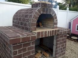 I think having an outdoor pizza oven would be the ultimate entertaining  piece for the back patio. I am sure there would be a bit of a learning  curve though ...