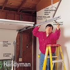 how to replace garage door rollersHow to Install a Garage Door  Family Handyman