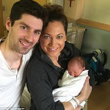 ABC's Ginger Zee and husband Ben Aaron share photo of son Adrian Benjamin |  Daily Mail Online