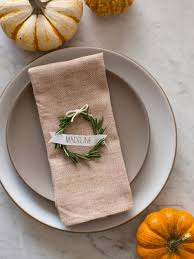 11 of our favorite diy wedding place card ideas weddingomania Rustic Wedding Place Card Ideas rustic diy rosemary wreath place cards for your winter wedding (via weddingomania) rustic wedding place card holders