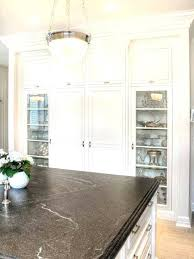 an example of a black honed granite in kitchen with white cabinets colors dark