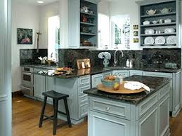 white kitchen color with granite countertops and backsplash with oak cabinets