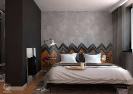 wood and tile herringbone sets the backdrop for this dark comfortable bedroom matte black