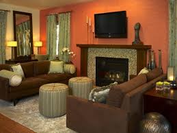 sage green fireplace with orange wall color for traditional family room décor ideas using simple wall design