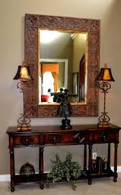 antique entryway table. Carving Wooden Wall Mirror Entry Table Using Double Antique Shade Lamp On Desk For Traditional Foyer Entryway E