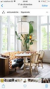 upholstered booth and modern handing light fixture at la brerie auteil