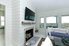 wood wall fireplace living room white island white living room with wooden walls fireplace beach style