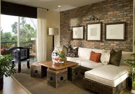 decorated living room with brick accent wall