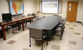 these conference style classrooms have large shared tables and individual seats ideal for smaller classes and round table group discussion