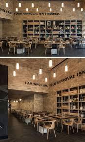 modern restaurant lighting. the walls of this restaurant are covered in wood shingles modern lighting