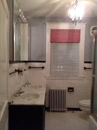 i want to replace the tub surround flooring vanity mirrors lighting to help update the existing b w wall tile this is my teenage son