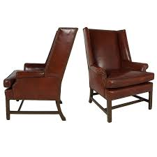 pair of leather wing chairs with nailhead trim for