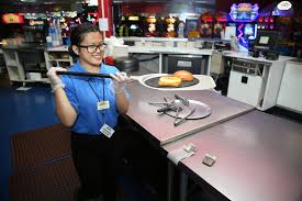canyon springs high school graduate angelica tariman 17 works in the kitchen at the