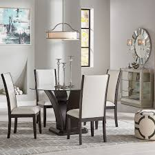 For a cohesive feel, opt for seating in the same material as the table, or go eclectic with colorful chairs. Tory 5 Pc Round Dining Set Badcock Home Furniture More