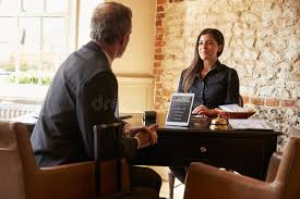 guest talking to woman at hotel check in desk stock image image 71529197