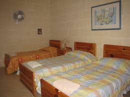 the top floor consists of 3 bedrooms where one bedroom has a double bed an other has 3 single beds and the 3rd is with 2 single beds