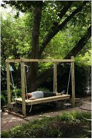 exotic outdoor swing bed woman relaxing on a hanging bed outdoors under a tree outdoor swing exotic outdoor swing bed