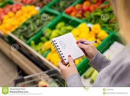 Grocery Store Product List Woman With Notebook In Grocery Store Closeup Shopping List On