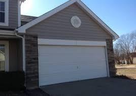 wood veneer garage doors method for applying wood veneer to metal garage doors our house