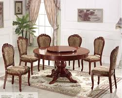 elite round dining table with lazy susan and 6 chairs