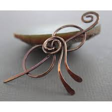 shawl pin or scarf pin in copper rose bud bow design as seen in vogue knitting early fall 2016