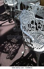 white wrought iron furniture. antique whitepainted wrought iron chairs sit in the sunlight on paddle wheel riverboat white furniture
