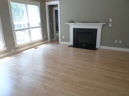 Cool White Best Laminate Flooring Tile For Contemporray Living Room  Completed With Black Fireplace Combined With