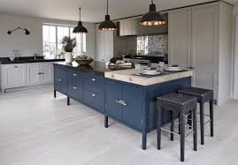 kitchen blue stained wooden island black patterned marble