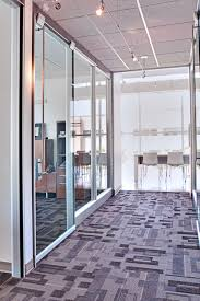 As a two-storey glass box, natural light access and control are critical to  the layout of this space.