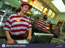 multi national staff stock photos multi national staff stock mcdonalds girl serving customer in brent cross branch london england stock image