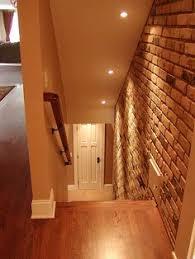lighting in basement. open basement stairs like the lighting in
