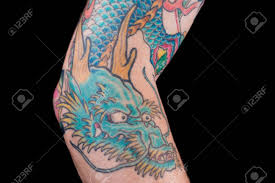 A Detailed Shot Of A Bluegreen Dragon Tattoo In Japanese Style