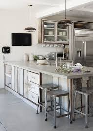 the kitchen of actress turned designer amanda pays features matte finished concrete countertops as