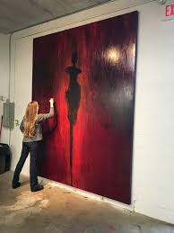 artist and manager at work on wall street fine art gallery with art management services in jacksonville florida