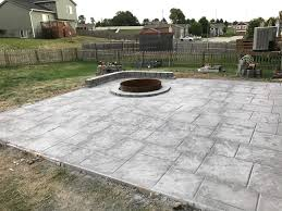 concrete patio with fire pit. Fine Pit Stamped U0026 Colored Concrete Patio Fire Pit Sitting Wall  Water Drainage  Retaining Siding Roofing Omaha Contractor On Patio With I