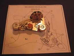 i love eric johnson strat wiring here s some decent pics i found of the mod