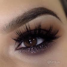 dark smokey eye with glitter love her lashes