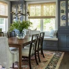 elegant dark wood floor and brown floor enclosed dining room photo in boston with gray walls