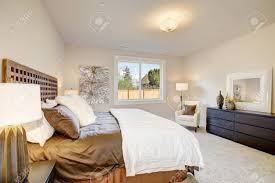 Light Brown And White Bedroom Light Filled Bedroom Boasts A King Size Bed With Wood Headboard