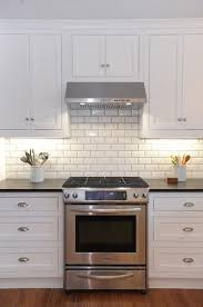Subway Tile Backsplash Patterns Cool White Kitchen Cabinets With White Subway Tile Backsplash Beveled