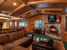 living room surprising rustic log cabin living room decorate with stoned fireplace under tv wall