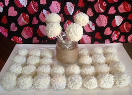 Lemon Cake Pops Covered In White Chocolate And Shredded Coconut