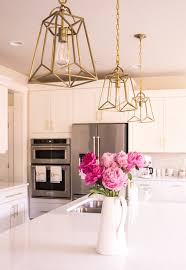 white and gold kitchen gold lantern pendant lights pink peonies