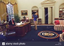 clinton oval office. Chelsea Clinton Playing With Socks The Cat In Oval Office. At Left, President Bill Works His Desk. Dec. 24, 1994. (BSLOC20152201 Office T