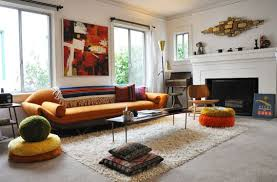 This bright and airy living room showcases a relaxed boho style that was  very popular in the 1960s. 60s Swank