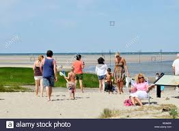 Rock Harbor Cape Cod Tide Chart People Walking In Sand At Rock Harbor Beach In Orleans Cape
