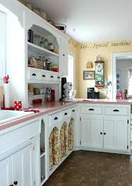 a finished kitchen with white cabinets and pink granite countertops for countertop decor 13
