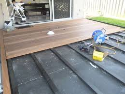 how to lay deck flooring on a concrete patio composite decking over concrete porch